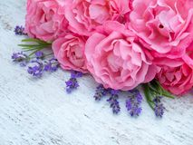 Pink roses and lavender bouquet on the white background Royalty Free Stock Photos