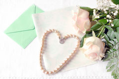 Pink roses and letter. royalty free stock photos