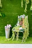 Pink roses in metal bucket and decoration chair on artificial gr Stock Images