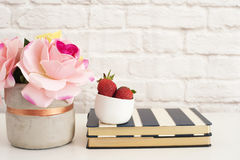 Pink Roses Mock Up. Styled Photography. Brick Wall Product Display. Strawberries On Striped Design Notebooks. Vase With Pink Roses Royalty Free Stock Photography