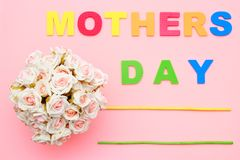 Pink roses with for Mothers day on background of text, flat ray. Copy space. Top view. royalty free stock photos
