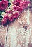 Pink roses on old wooden board Stock Photography