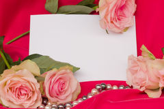 Pink roses with pearls strand and blank card Stock Image