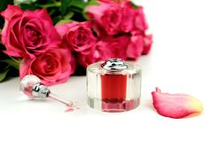Pink roses and perfume,. On white background Stock Image
