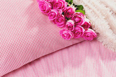 Pink roses on pillow Stock Image