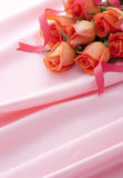 Pink roses on pink satin Royalty Free Stock Photo