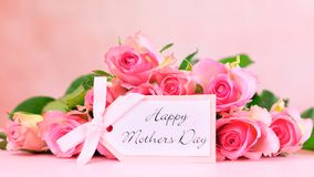 Pink roses on pink wood table, Mother`s Day background closeup. Royalty Free Stock Photos