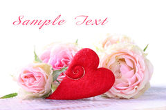 Pink roses and red heart Stock Images