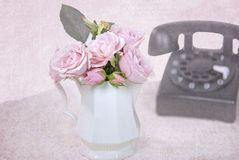 Pink roses with retro telephone Stock Photography