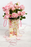 Pink roses in shopping bag with floral ornaments Royalty Free Stock Image