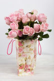 Pink roses in shopping bag with floral ornaments Stock Photo