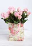 Pink roses in shopping bag with floral ornaments Royalty Free Stock Photography