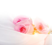 Pink roses on silk Stock Photography
