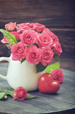 Pink roses with stone heart Royalty Free Stock Image