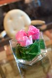 Pink roses table centrepiece in hotel lobby Stock Photo