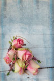 Pink roses on textured table Stock Image