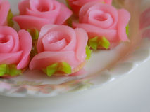 Pink roses use for decorate cake. On beautiful plate Royalty Free Stock Photos
