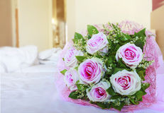 Pink roses of valentine flowers bouquet on white bed with copy s Stock Images