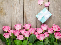 Pink roses and valentines day gift box Stock Photos