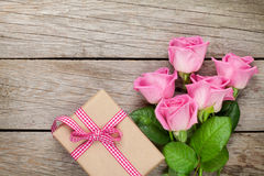 Pink roses and valentines day gift box over wooden table Royalty Free Stock Photography