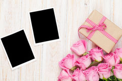 Pink roses and valentines day gift box and two blank photo frame Royalty Free Stock Images