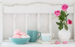 Pink roses in vase and dinnerware Stock Images