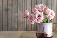 Pink roses in a vintage jug Stock Images