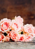 Pink Roses on Warm Wooden Background Stock Photo
