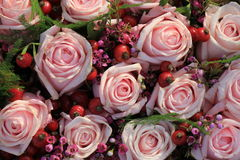 Pink roses wedding bouquet. Pink roses and berries in a wedding arrangement Stock Image