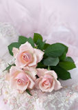 Pink roses on wedding lace (copy space). Three pink roses on wedding lace (shallow depth of field, copy space Royalty Free Stock Images
