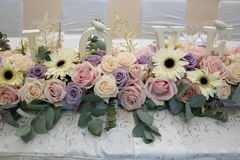 Pink roses on the wedding table. Love. Royalty Free Stock Images