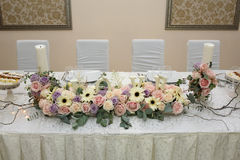 Pink roses on the wedding table. Love. Royalty Free Stock Image