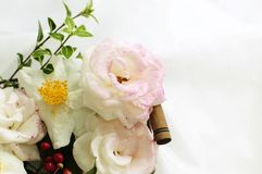 Pink roses and white camellias in a basket Royalty Free Stock Images