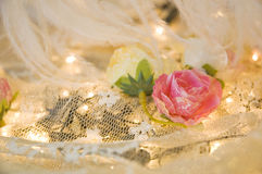 Pink roses on white lace Stock Images