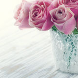 Pink roses in a white lace vase Stock Photos