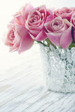 Pink roses in a white lace vase Stock Photo