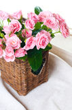 Pink roses in a wicker basket and linen fabric Stock Photography