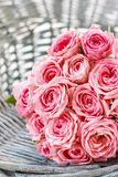 Pink roses in wicker basket Stock Photos