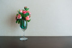 Pink roses in a wine glass Royalty Free Stock Images