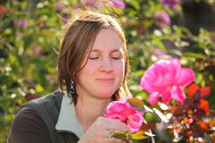 Pink roses and a woman Stock Images