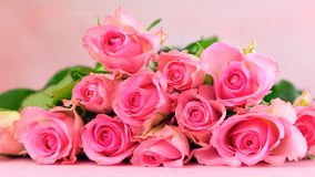 Pink roses on pink wood table, Mother`s Day background closeup. Pink roses on pink wood table, Happy Mother`s Day background closeup Royalty Free Stock Photos