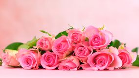 Pink roses on pink wood table, Mother`s Day background closeup. Pink roses on pink wood table, Happy Mother`s Day background closeup with copy space Stock Images