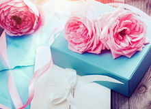 Pink roses on wooden background in vintage style Stock Photography