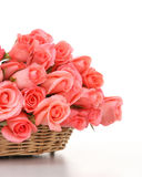 Pink roses in wooden basket Stock Image