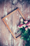 Pink roses and a wooden frame Royalty Free Stock Photography