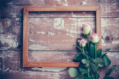 Pink roses and a wooden frame Stock Photo