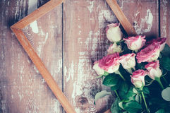 Pink roses and a wooden frame Stock Images