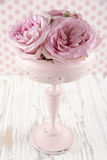 Pink roses in a wooden pastel color vase Stock Photo