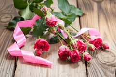 Pink roses on a wooden table Stock Images