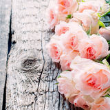 Pink Roses on Wooden Table, toned image square Royalty Free Stock Photography